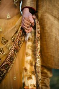 Indian Bride and Groom holding hands